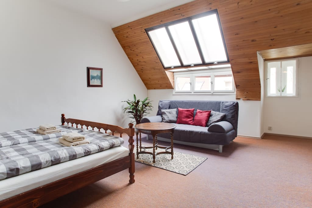 Master bedroom with large double bed and convertible sofa for other two guests. You will stay right in the middle of Prague Old Town, but in very quiet and large apartment with great view to Jewish Quarter roofs.