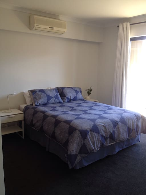 Queen bedroom has air conditioning and a small balcony