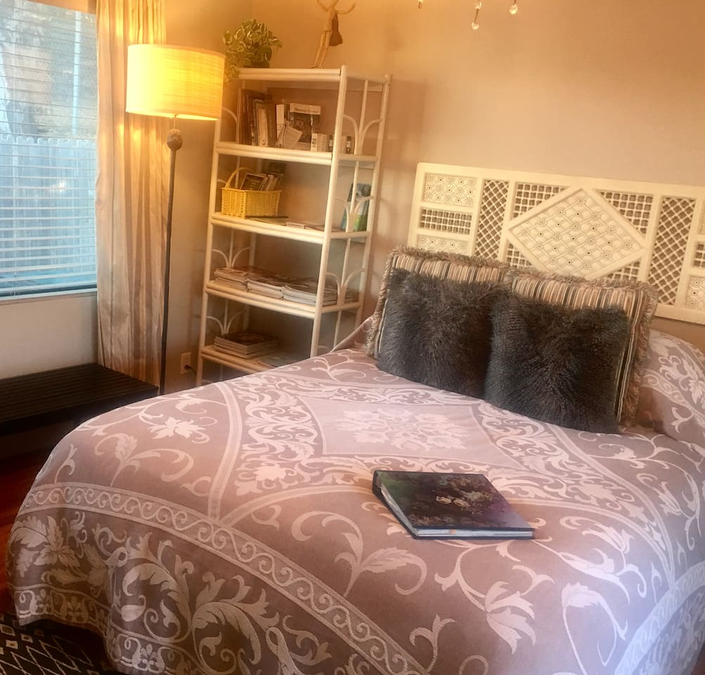 Comfy Queen bed and lots of reading material on the area...FAQ binder too.