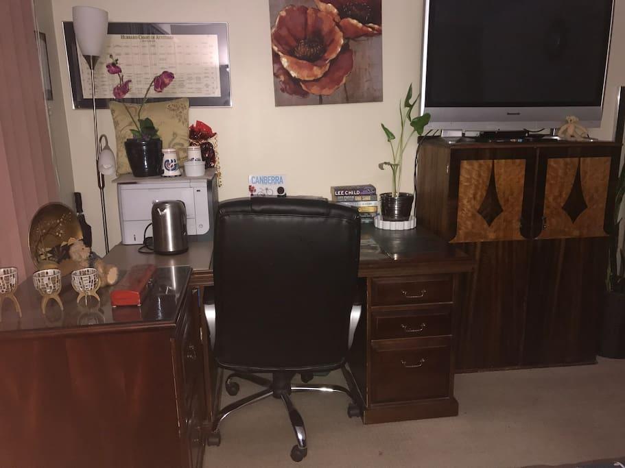A desk, TV, DVD player, kettle