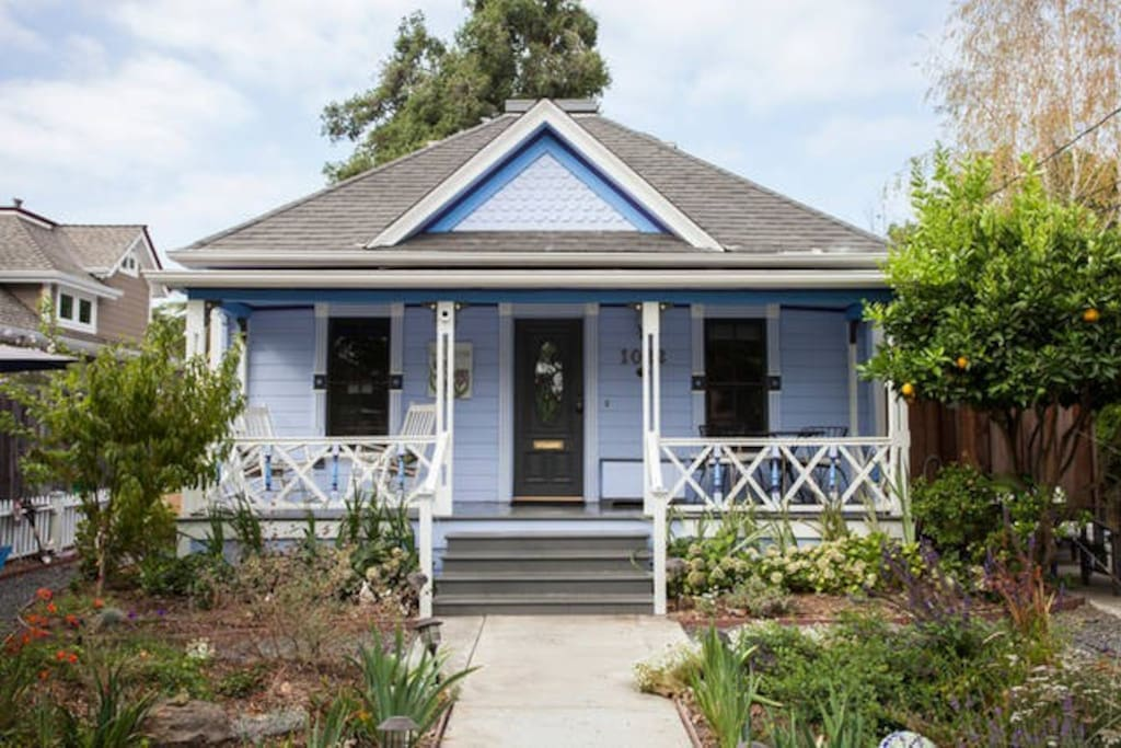 Iris House is a painted lady Victorian in hues of blues and purples