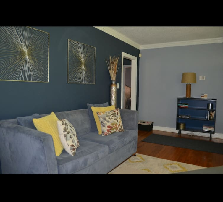 Living room to sit, relax & talk. Couch also has a pull out bed already made to rest.