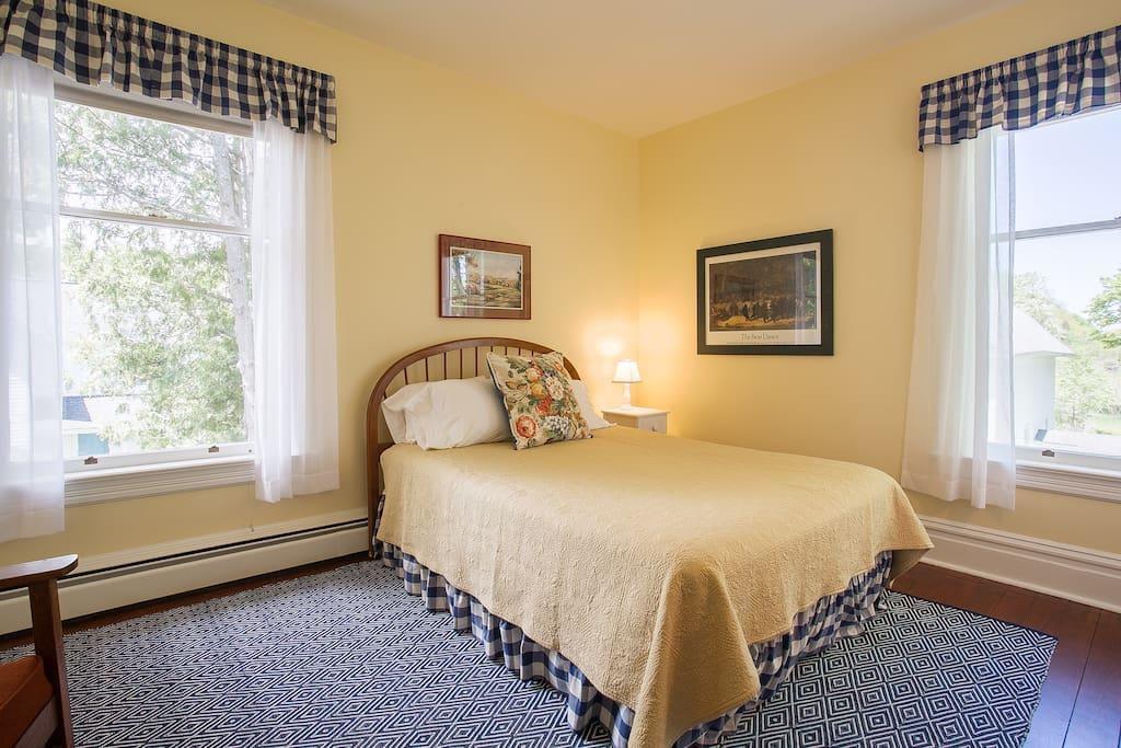Sleeping Bear bedroom - 2 large windows, facing west and north