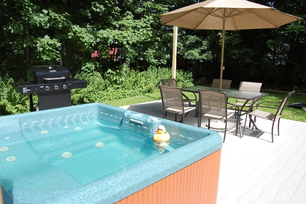 Jacuzzi on new deck in back yard with gas grill and seating for 6