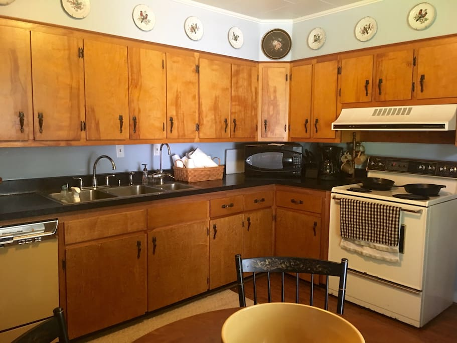 Fully stocked kitchen! Oven, stove, microwave, toaster oven, coffee machine, full fridge, and dishwasher.