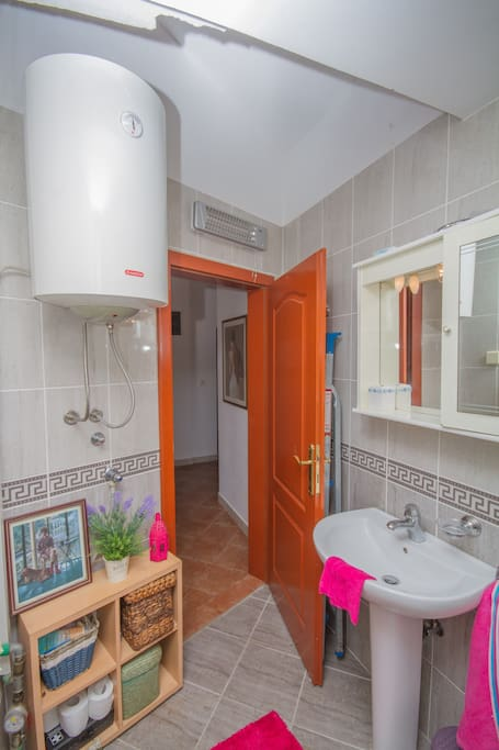 Shower room with h/basin and w/c.