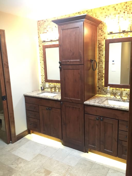 His and hers vanity spa like master bathroom. Water closet for private toilet.