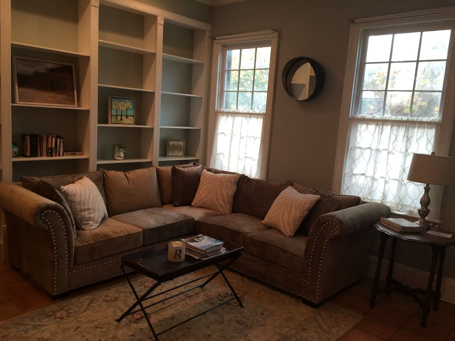 Beautifully decorated in breezy cottage colors, the open living room will feel like home.
