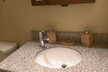 Hand sink with lotion and soap provided.