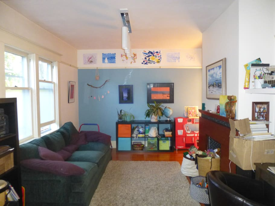 Kid friendly living room and former coal fireplace