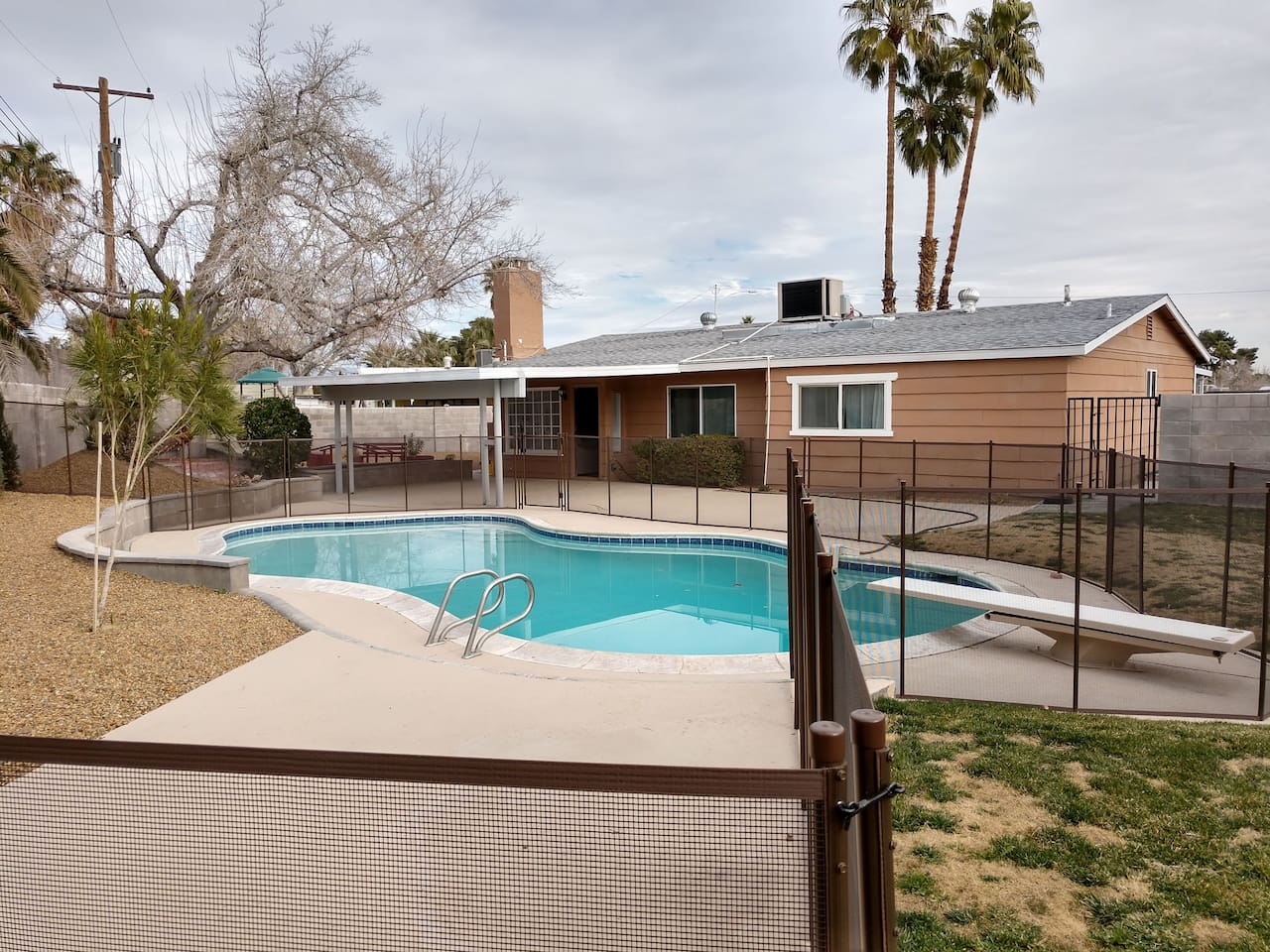 Private backyard fenced in pool with diving pool