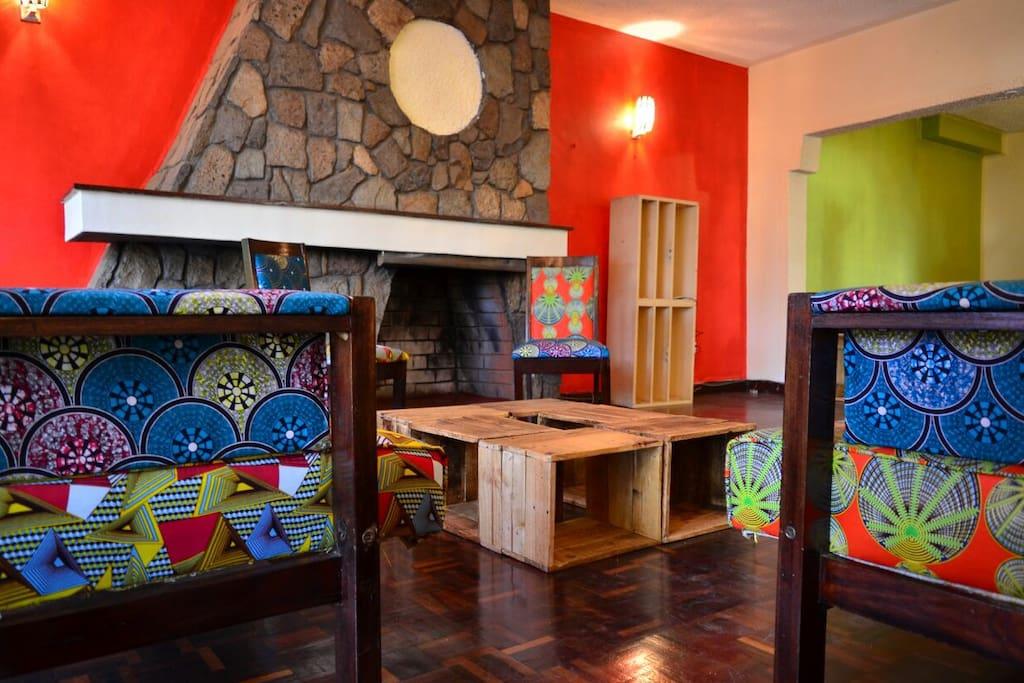 Living Room w/ Kitenge Fabric Sofas + Pallet Table / Stools