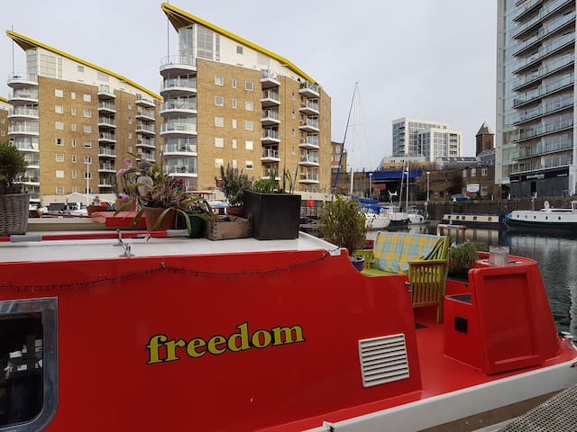 Canal boat with grand piano,  Limehouse Marina