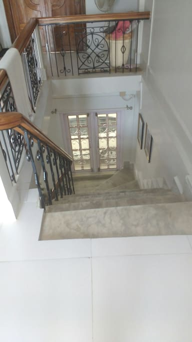 Stairs to the 1st floor, if you want to access the main porch.