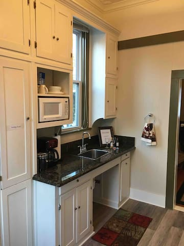 Kitchen. Granite counter top stainless steel sink.  Fresh roasted coffee beans are supplied for your morning enjoyment.