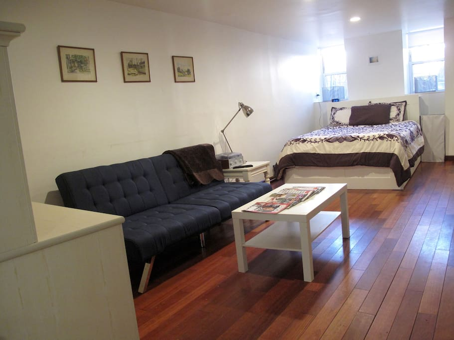 Main room with Desk, Couch and Coffee Table