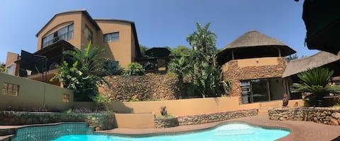Ndlulamithi Urban Lodge Room 1 of 3