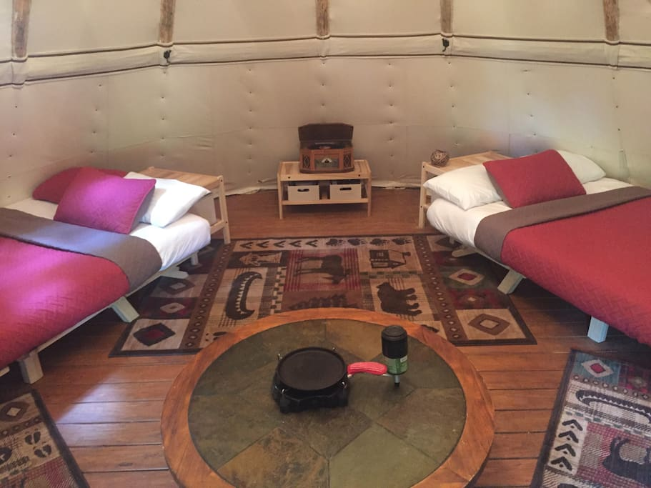 Equipped with 3 beds (2 queen and 1 full) this spacious tipi is ready for a couples retreat or the family. Table top propane stove is shown in the middle of the table with cast iron pan for your cooking convenience!
