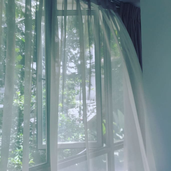 Your bedroom is surrounded by greens.
