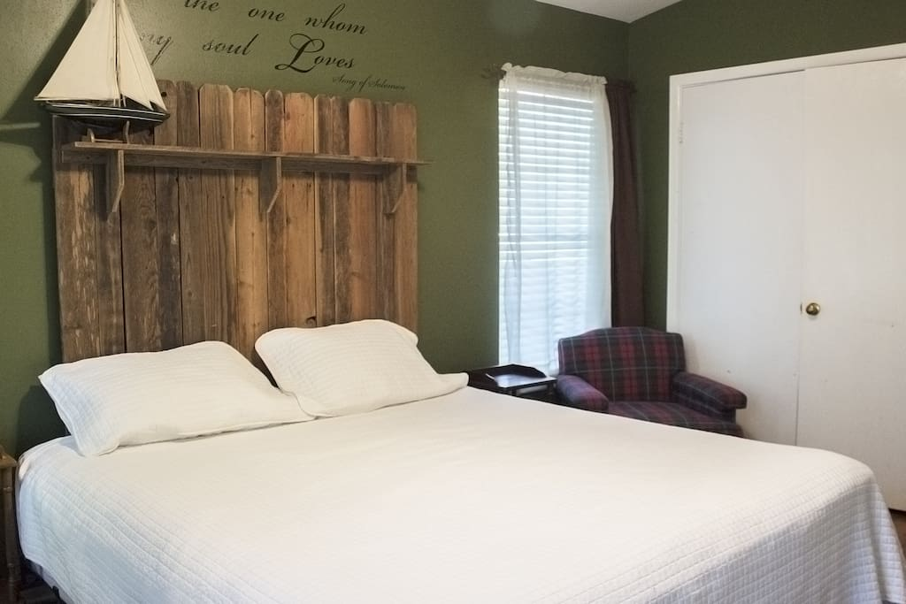This homemade headboard has a cabin feel to it.