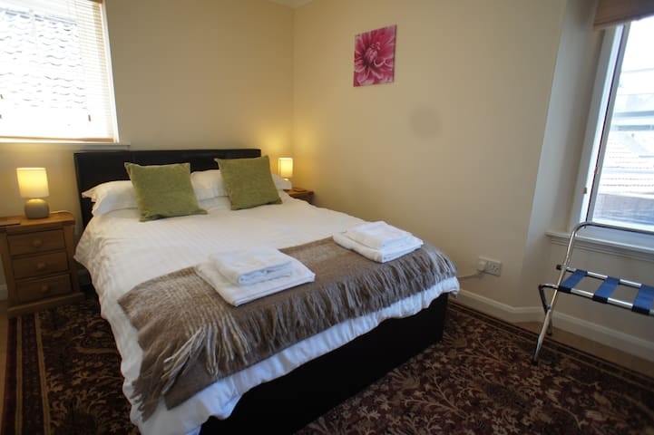 Sunny and bright double bedroom, with quality bed linen and towels