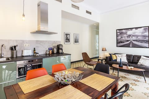 Our bright and welcoming living room and dining area. Perfect for a dinner and drinks among family and friends