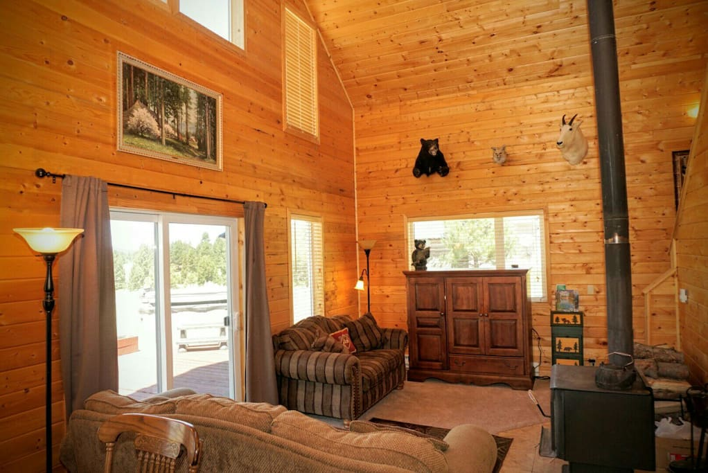 The comfortable lounging living area of the cabin, along with a tv located in the cabinet. There is also internet tv.