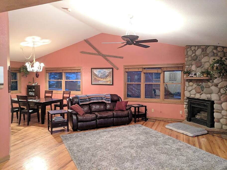 Spacious living room with gas fireplace and dining room beyond