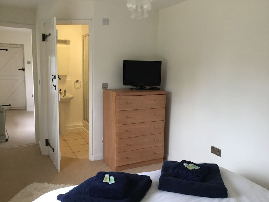 Bedroom with ensuite shower, king size bed and freeview television