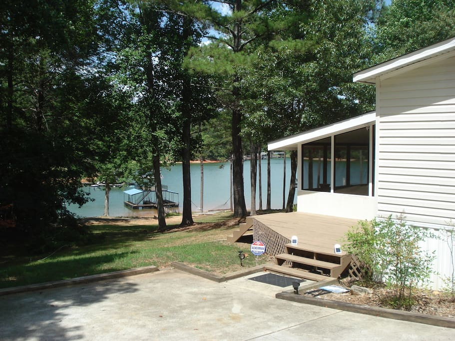 Large driveway with view of lake