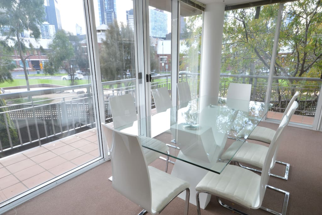 We have an 8 seat dining setting overlooking a garden, playgrounds and the city skyline