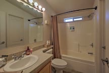 Prepare for a night at the casino in this large bathroom.