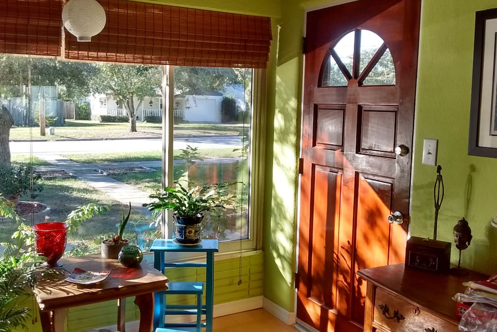 Sunny entryway into dining room/living room.