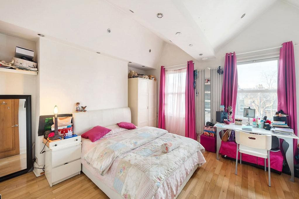 Large and beautiful double bedroom with workspace, double bed and sofa