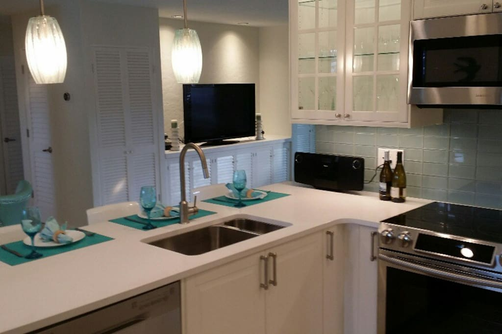Kitchen with TV in background