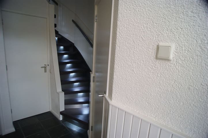 Stairs to the first floor and bathroom