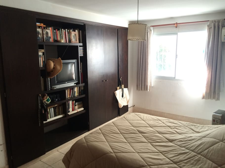 Spacious Room, bed, window, tv, and furniture