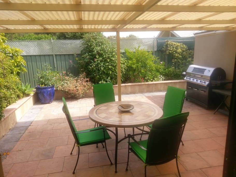 Spacious alfresco area with BBQ and easy access to kitchen.