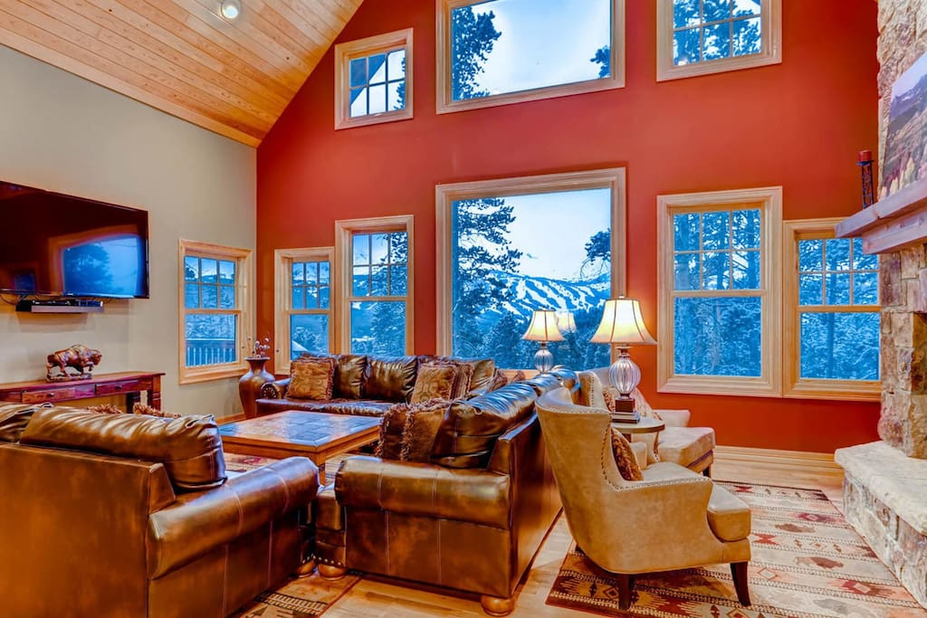The living room offers a sitting area with a flatscreen TV and a fireplace.