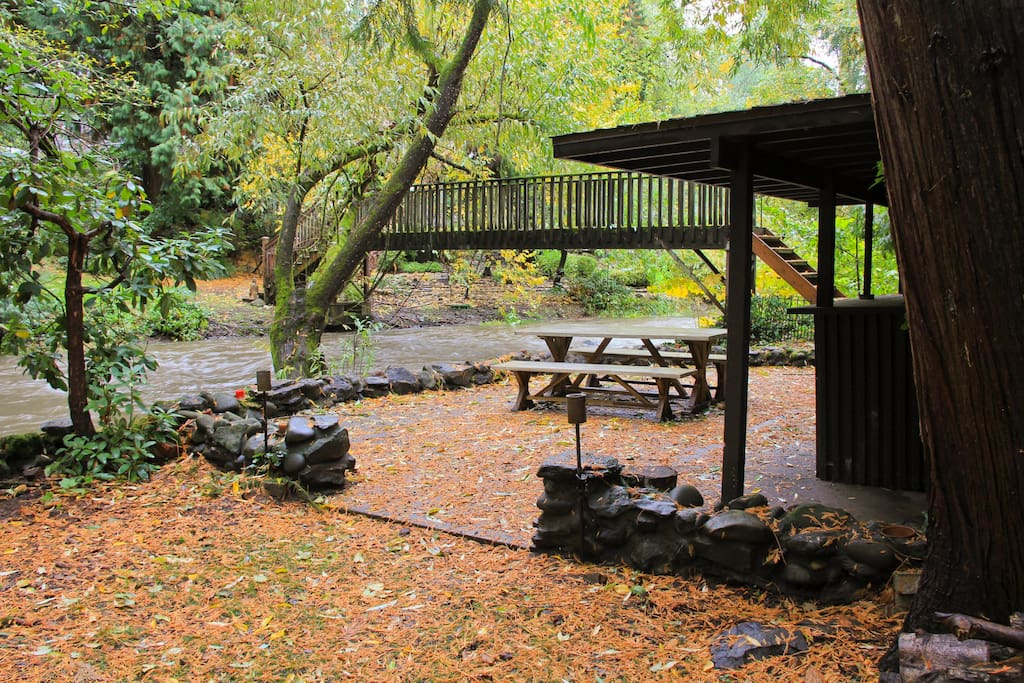 Picnic area and creek behind the cabin
