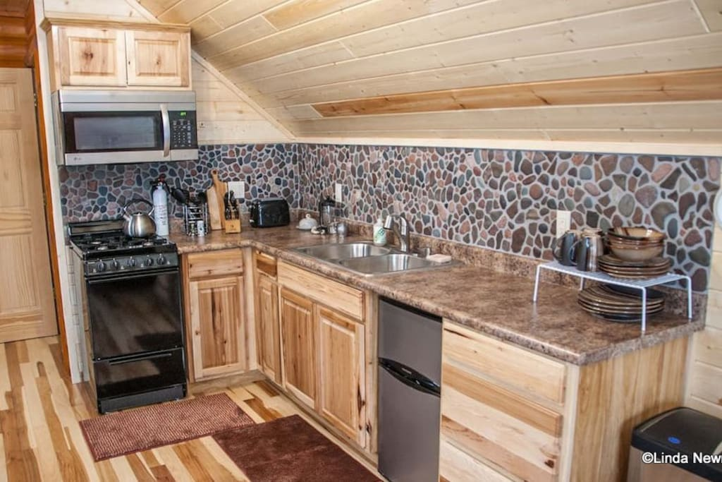 The kitchen has hickory cabinets and a hand-picked Lake Superior stone back splash