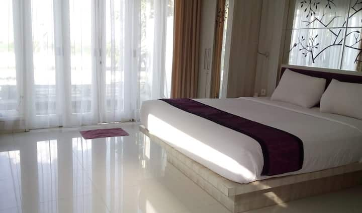 A pool villa of a bedroom with kitchen at Jimbaran