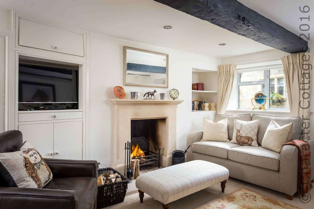 Enter into the living room and relax in front of the roaring fire