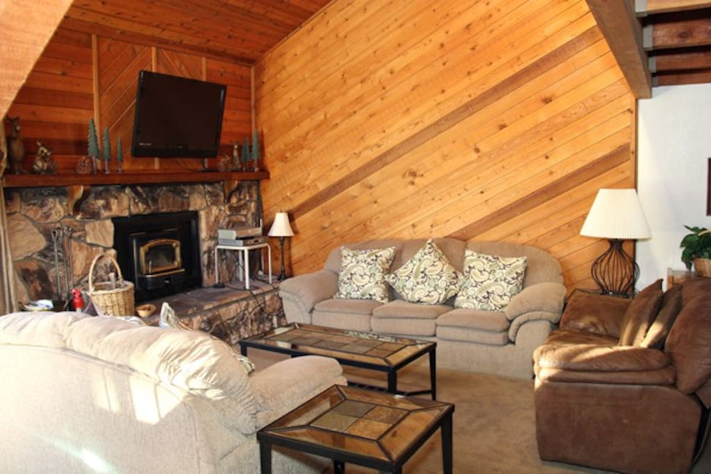 Mammoth Lakes Condo Rental Snowflower 65 - Living Room with Flat Screen TV and Woodstove