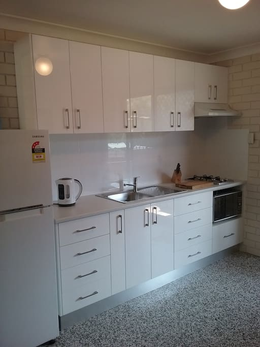 Kitchen includes gas cooktop, convection microwave, toaster, kettle, rice cooker,  cooking gear and stick mixer.