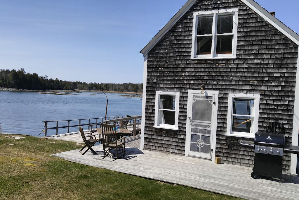 Cottage sits over the water with 4 sided deck.