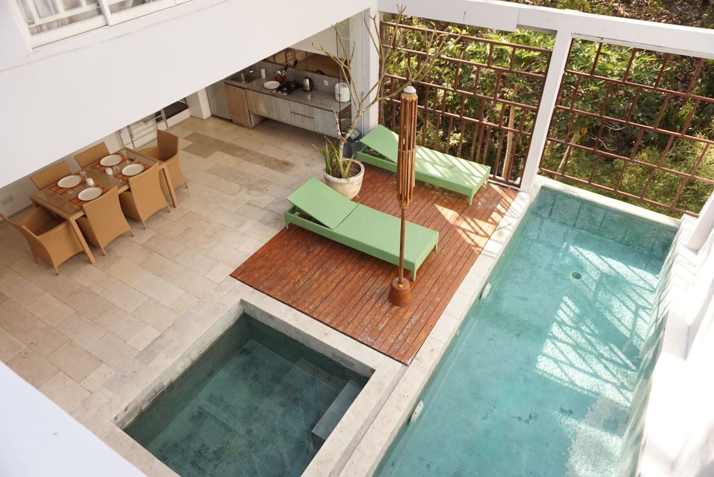 Swimming pool, dining area, and kitchen