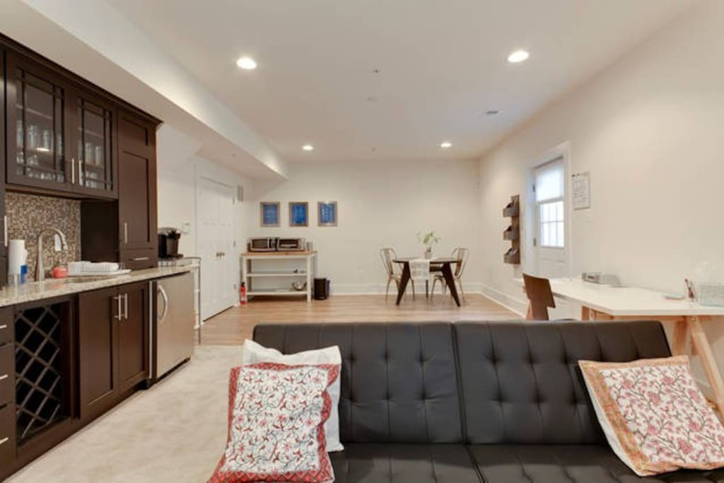 Be right at home in this bright and spacious main room with wet bar, kitchenette, dining table, work desk, and futon that folds into a bed
