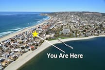 Where the beach meets the bay and so close to dozens or restaurants and boutique shops