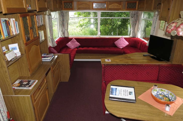 Living area of this deluxe caravan with renewed upholstery and carpet.